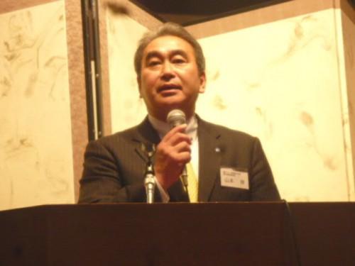 常務取締役の山本律愛生舘営業部長